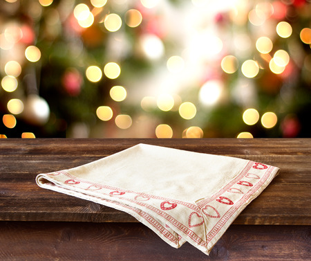 festivity: Christmas holiday background with rustic table over christmas bokeh for product montage