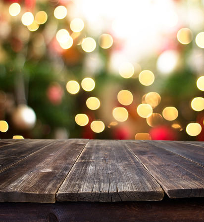 Christmas holiday background with empty rustic table over christmas bokeh for product montage