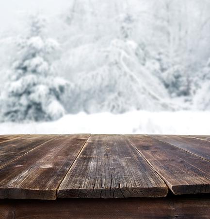 rustic table against winter landscape