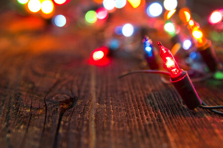 christmas lights on old wooden rustic board, selective focus