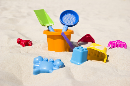 sand mold: children39s toys on a beautiful beach sand