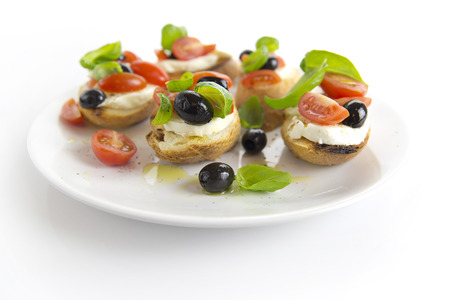bruschetta: bruschetta over white plate