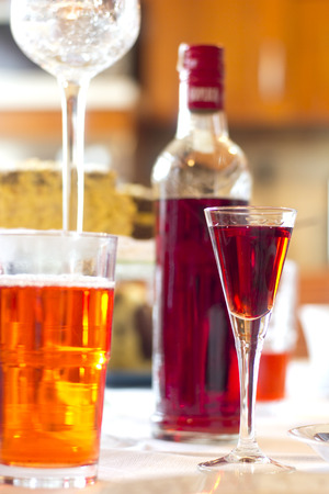 alcohol bottles: cherry liqueur on the table