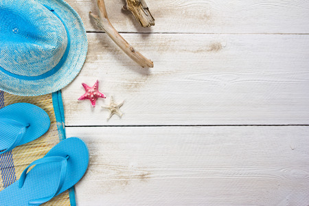 accesories: beach accessories on white wooden boards