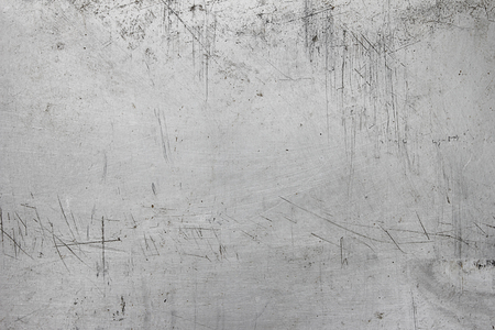 scratched: weathered and scratched grunge aluminum background