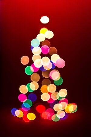 christmas tree decoration: Christmas tree shape lights out of focus Stock Photo
