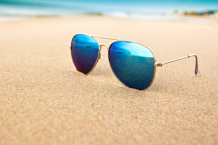 reflection: sunglasses on the beach