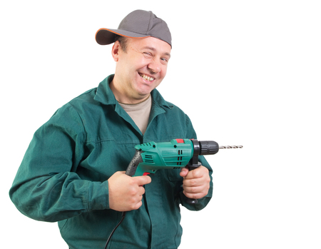 Funny workman with a drill, isolated on white background with clipping path included Stock Photo