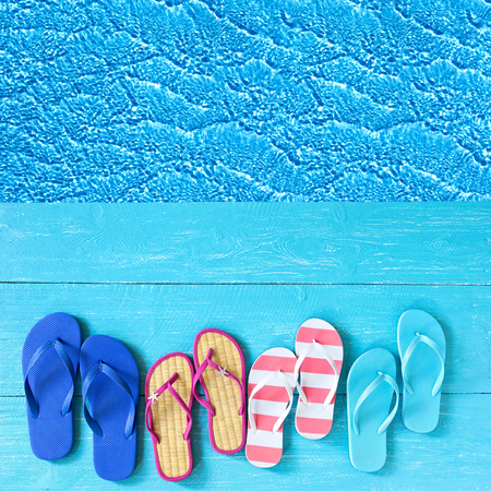 thongs: thongs on the blue planks against blue water