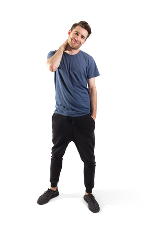 nonchalant: handsome young man standing isolated on white background with clipping path included