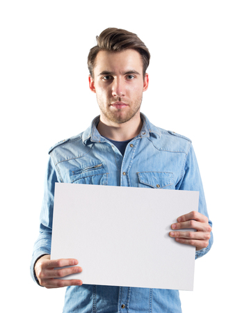 white poster: Young man showing a blank page paper ready for text or product, two clipping paths included, one for the body and for the second page