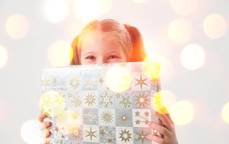 happy christmas: happy child holding christmas present Stock Photo
