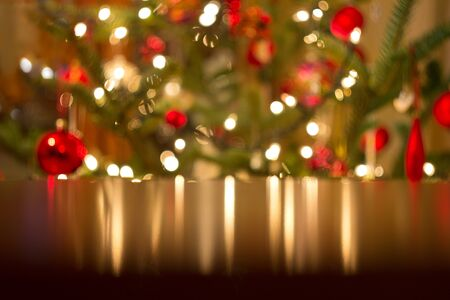 Christmas background, defocused lights reflect in the table
