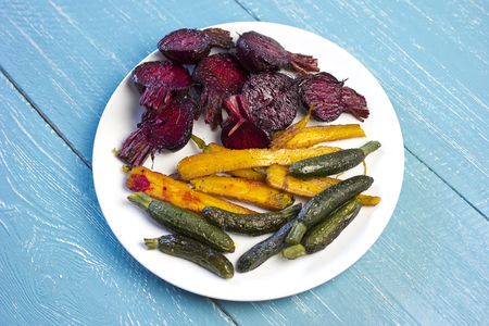 Boiled and fried organic vegetables, beetroots, carrots and zucchini