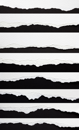 set of torn paper edges isolated on black Imagens