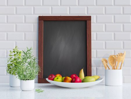 Mock up blackboard frame with herbs and fruits in the kitchen. 3D render image.