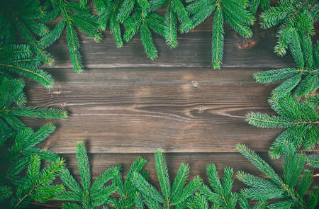 Christmas decoration. Fir tree frame on rustic, wooden background. High angle view. 免版税图像
