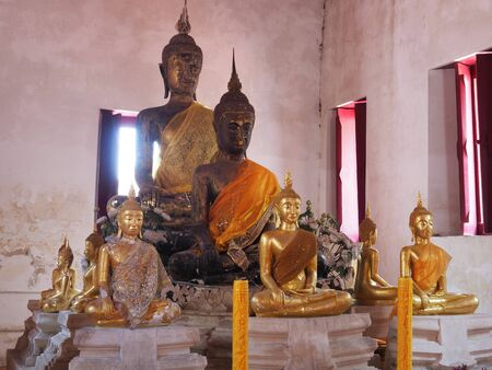 Old Buddha Principal with disciple statue