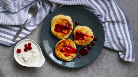 cottage cheese pancakes, tasty healthy breakfast, top view, grey stone background