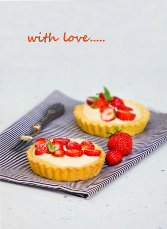 tartlets with custard and fresh berries, strawberry, valentins day Фото со стока