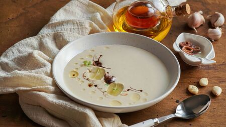 ajo blanco, spanish typical cold soup, made of almonds and garlic with olive oil and bread. white garlic soup