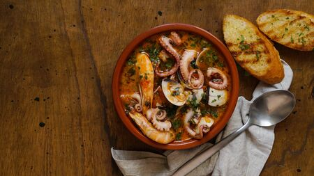 Spanish seafood stew, traditional northern meal, Caldereta or Zarzuela Stok Fotoğraf
