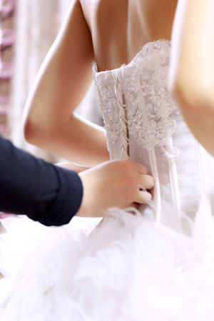 bridal gown: helping wearing a bridal gown
