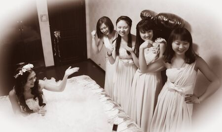 introducing: CHINA NANCHANG February 26, 2015: bride introducing her bridesmaids in the room