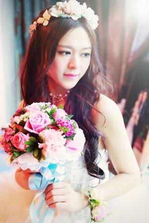 asian bride: CHINA NANCHANG February 26, 2015: An beautiful Asian bride posing for the wedding photo shooting