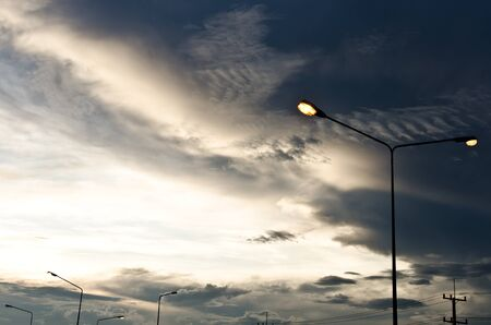 Light poles in evening on the street