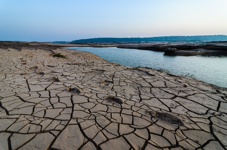unsheathing: cracked soil and pond in Sampanbok , in Mekong River, Ubon Ratchathani. Grand canyon in Thailand