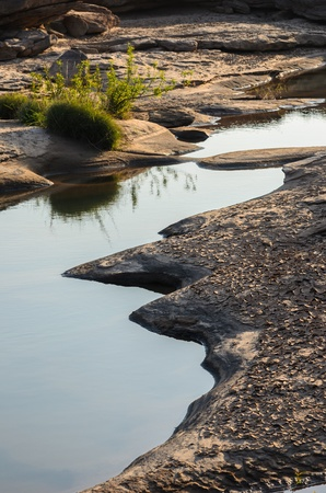 unsheathing: pond in Sampanbok , in Mekong River, Ubon Ratchathani. Grand canyon in Thailand Stock Photo