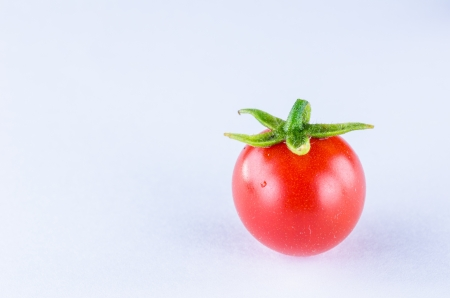Tomato small in Thialand vegetable on white background photo