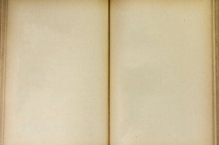 classics: Open old book brown paper background in classic concept