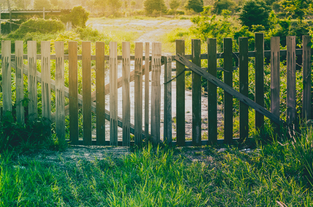 wooden fence and sunrise in the farm countryside Stock Photo