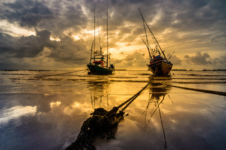 Fishing sea boat and Sunrise clouds before strom in Thailand blue  light tone photo