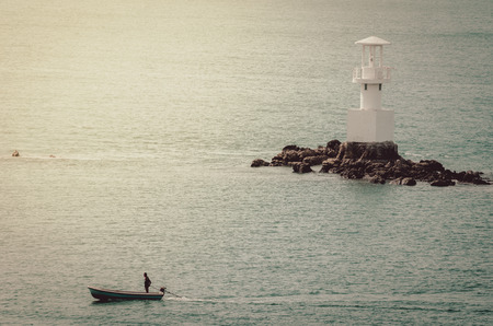 lobster boat: White Lighthouse on the sea and blue sky in Thailand vintage