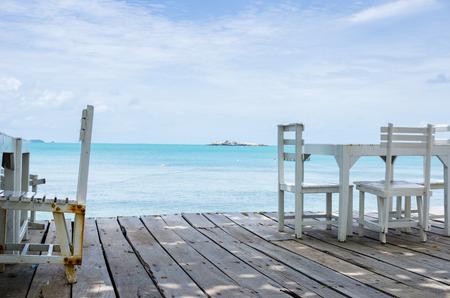 koh samet: Wood dock White chair and table in Koh Samet Thailand Stock Photo