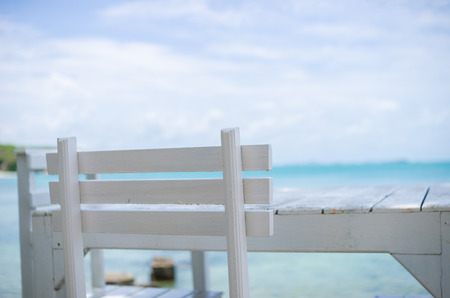 koh samet: Wood dock White chair and table in Koh Samet Thailand Stock Photo