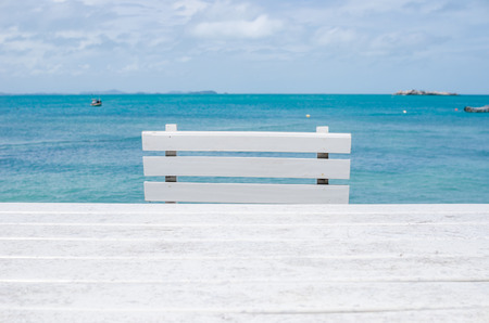 Wood dock White chair and table in Koh Samet Thailand Stock Photo