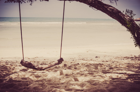 samet: swing on beach sand and sea in Koh Samet Thailand vintage