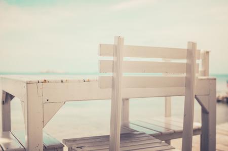 koh samet: Wood dock White chair and table in Koh Samet Thailand vintage