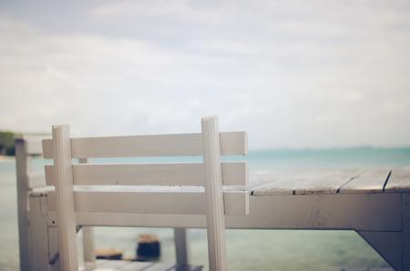 samet: Wood dock White chair and table in Koh Samet Thailand vintage