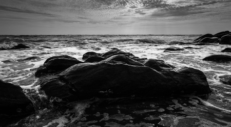 Black and white Beach rock and blue sea in Thailand Stock Photo