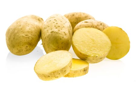 Isolated potatoes. Cut raw potato vegetables isolated on white background with