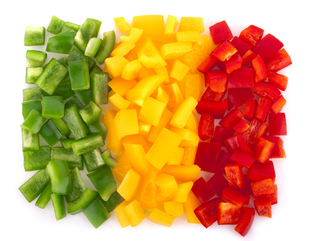 vegetarian bell peppers in various colors on white backgroud , topview