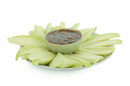 Mangoes with Sweet fish sauce on white background