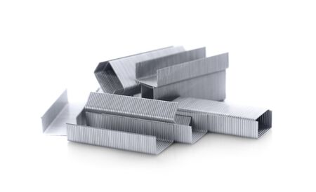 metal fastener: Stack of metal staples. Isolated on a white background.  Stock Photo