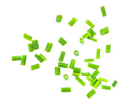 chopped green onions on white background Standard-Bild