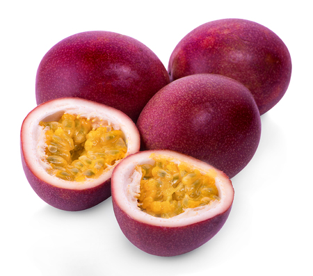 whole and half of passion fruit isolated on white background